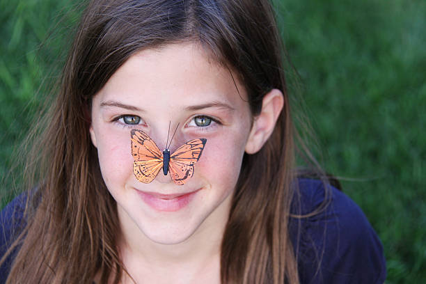 royalty free girl with a butterfly on a nose pictures images and
