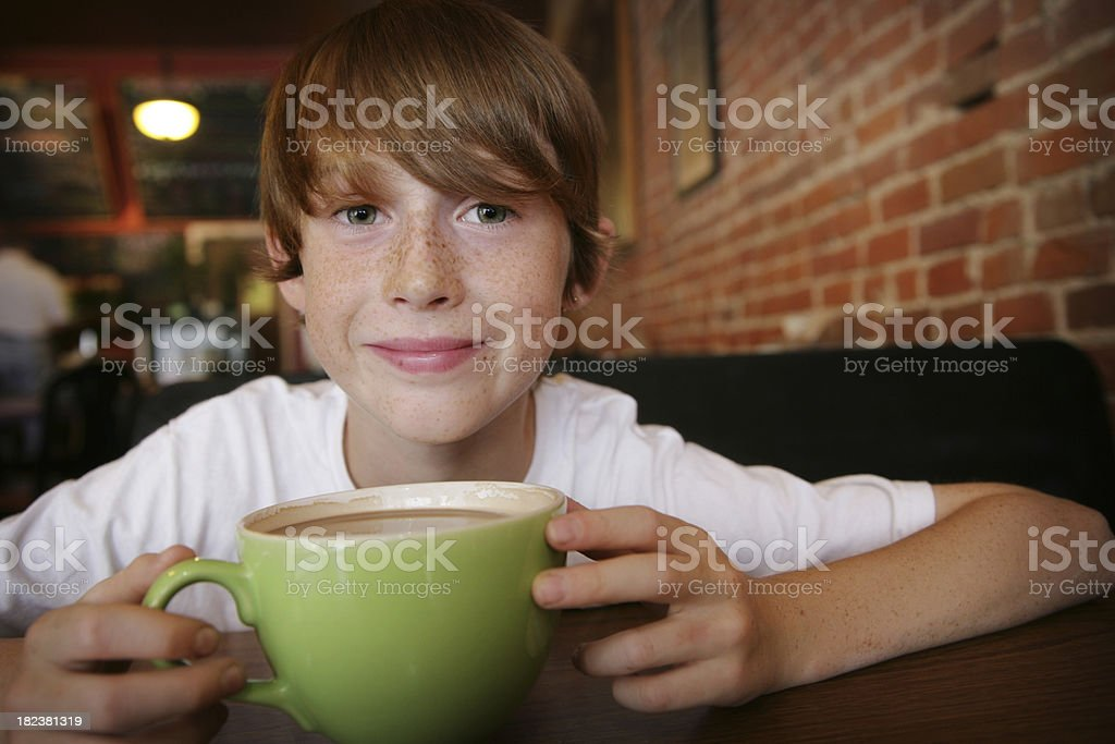 Cute Child with Hot Chocolate or Coffee royalty-free stock photo