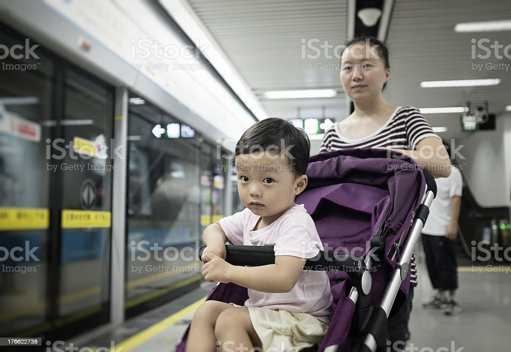 Cute children  and mother in the subway station royalty-free stock photo