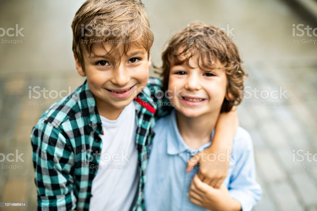 cute children, brothers, in a parkhaving fun Two cute children, brothers, in a park having fun Beautiful People Stock Photo