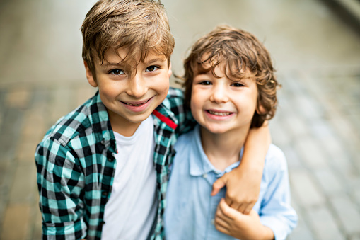 Cute Children Brothers In A Parkhaving Fun Stock Photo - Download Image Now