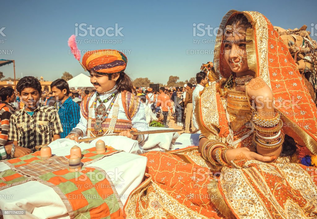 Cute children in old fashion indian costumes posing at carnival of the traditional Desert Festival stock photo