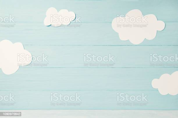 Cute children or baby card white clouds on the light blue wooden picture id1090975842?b=1&k=6&m=1090975842&s=612x612&h=vwwmxwksv77tky 7rwbppxotjycpgycoj32tzbvpqha=