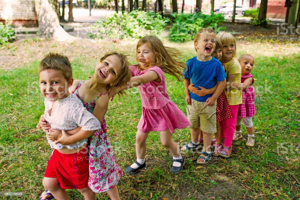 Kinder Garden: Cute Children Playing At Park Stock Photo & More Pictures