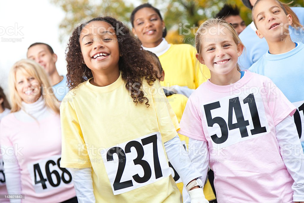 Cute children walking in a charity race royalty-free stock photo