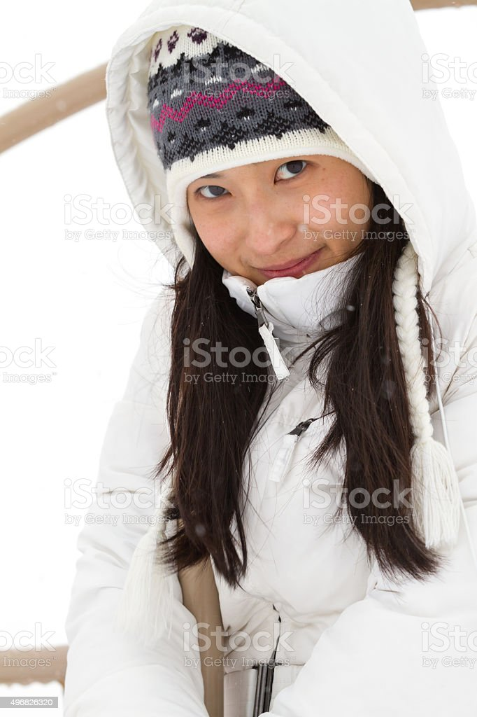 Cute Chinese Girl Wearing Winter Coat Stock Image