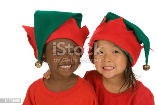 Adorable preschoolers wearing ready for Christmas and wearing elf hats