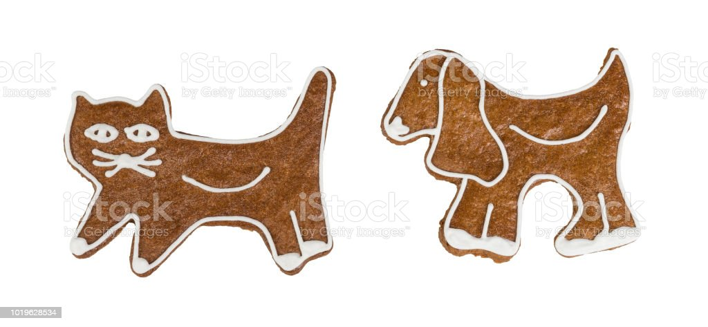 Cute Christmas gingerbreads in cat and dog shape. Isolated on white background stock photo