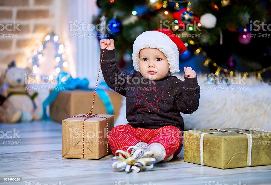 Cute christmas little baby child boy among Christmas decorations stock photo