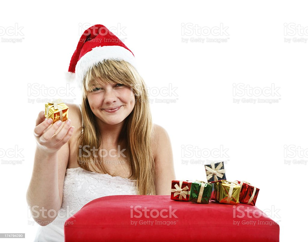 cute christmas teenage girl in red hat with presents smiles royalty free stock photo