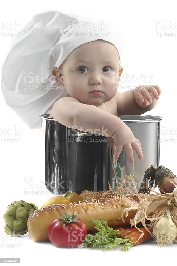 Cute Chubby Baby Chef in a Cooking Pot royalty-free stock photo