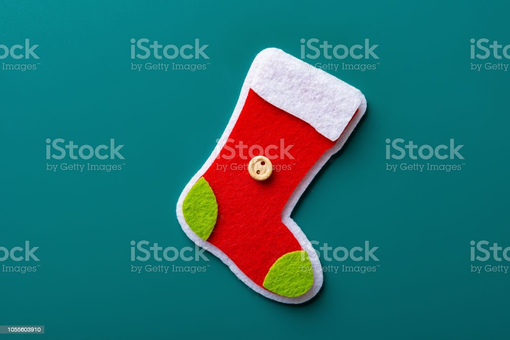 6cba2045795 Cute Colorful Christmas Sock On A Green Background Stock Photo ...