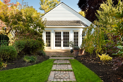 Cute cottage home with landscaped backyard.