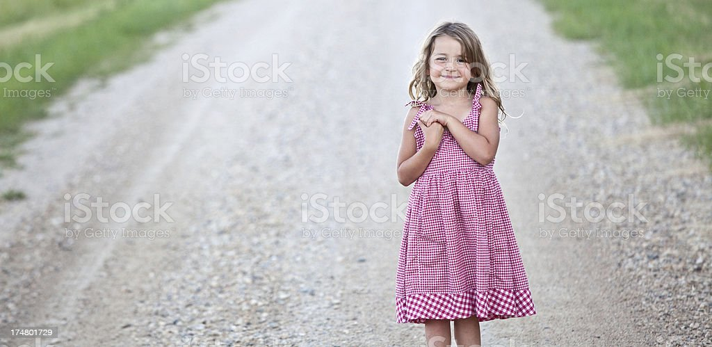 Cute Country Girl on Gravel Road royalty-free stock photo