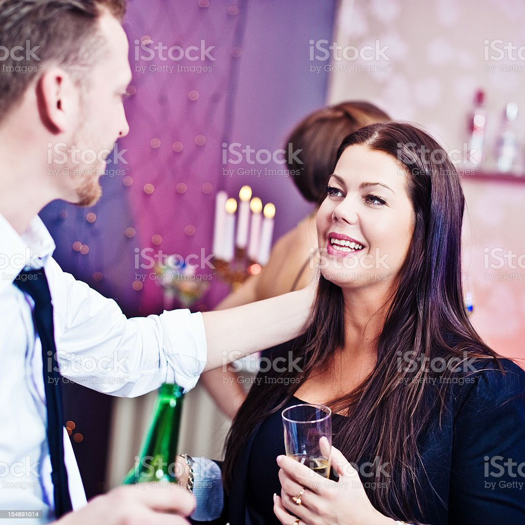 Cute couple at a party royalty-free stock photo