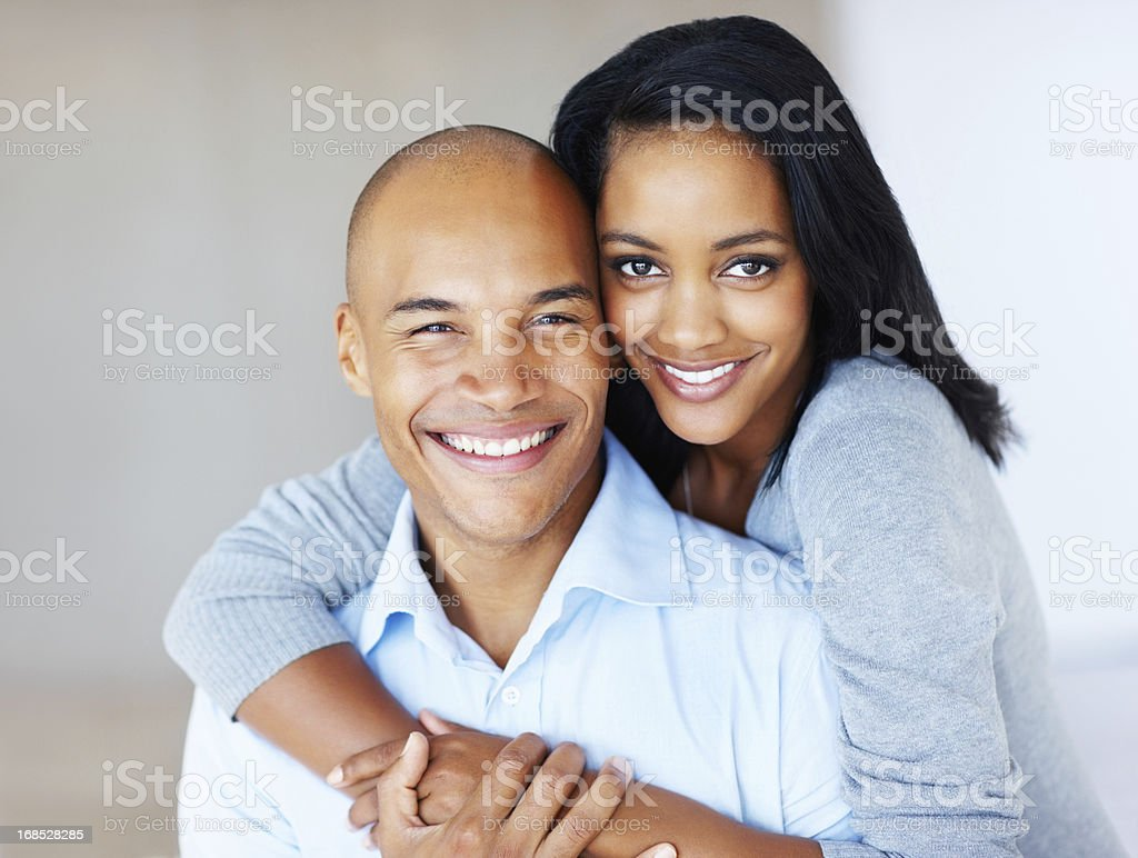 Cute couple embracing and smiling stock photo