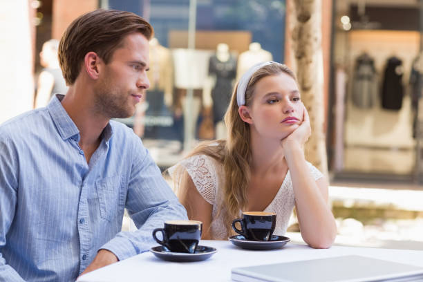 Cute couple facing relation difficulties stock photo
