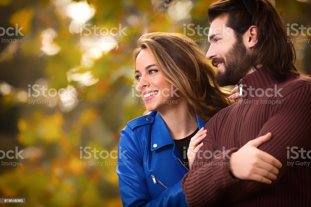 Cute couple hanging out in the park. stock photo