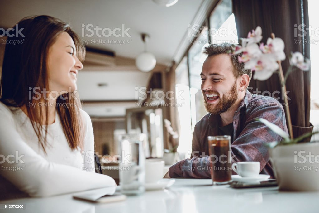 Cute Couple Having Great Time Socializing in The Morning stock photo