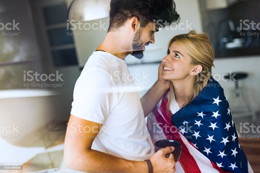 Cute Couple Hugging And Smiling In Their Home Stock Photo Download Image Now Istock