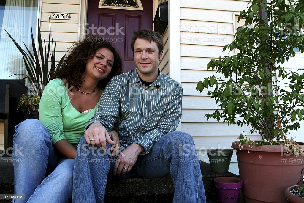 cute couple in front of house royalty-free stock photo