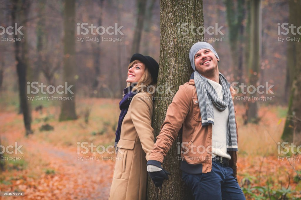 Cute couple in park filled with autumn colors. stock photo