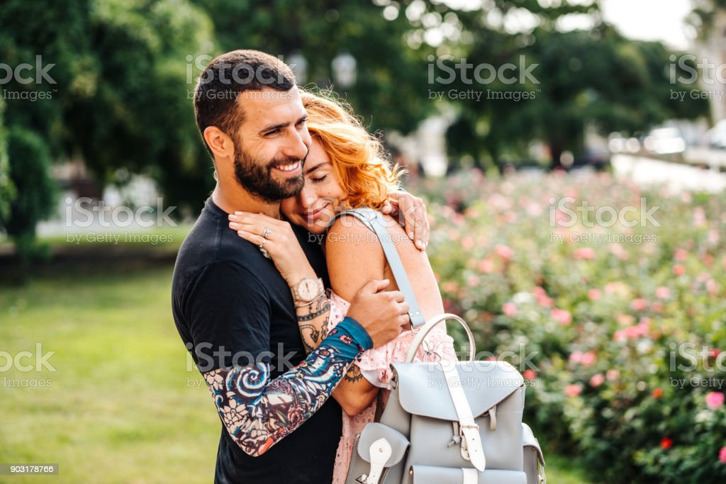 Cute couple in summer park stock photo