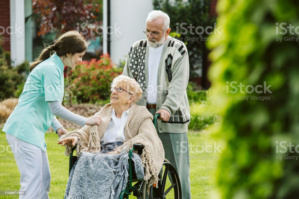 Cute Couple In The Nursing Home Garden Stock Photo Download Image Now Istock
