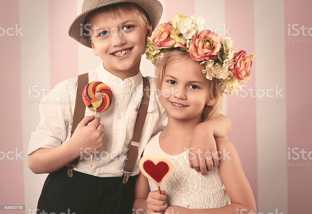 Cute couple of elementary age children stock photo more pictures cute couple of elementary age children royalty free stock photo thecheapjerseys Choice Image