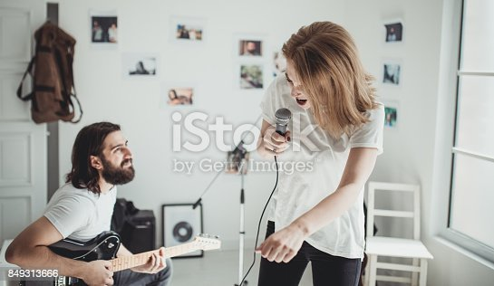 849362192 istock photo Cute couple of musicians 849313666