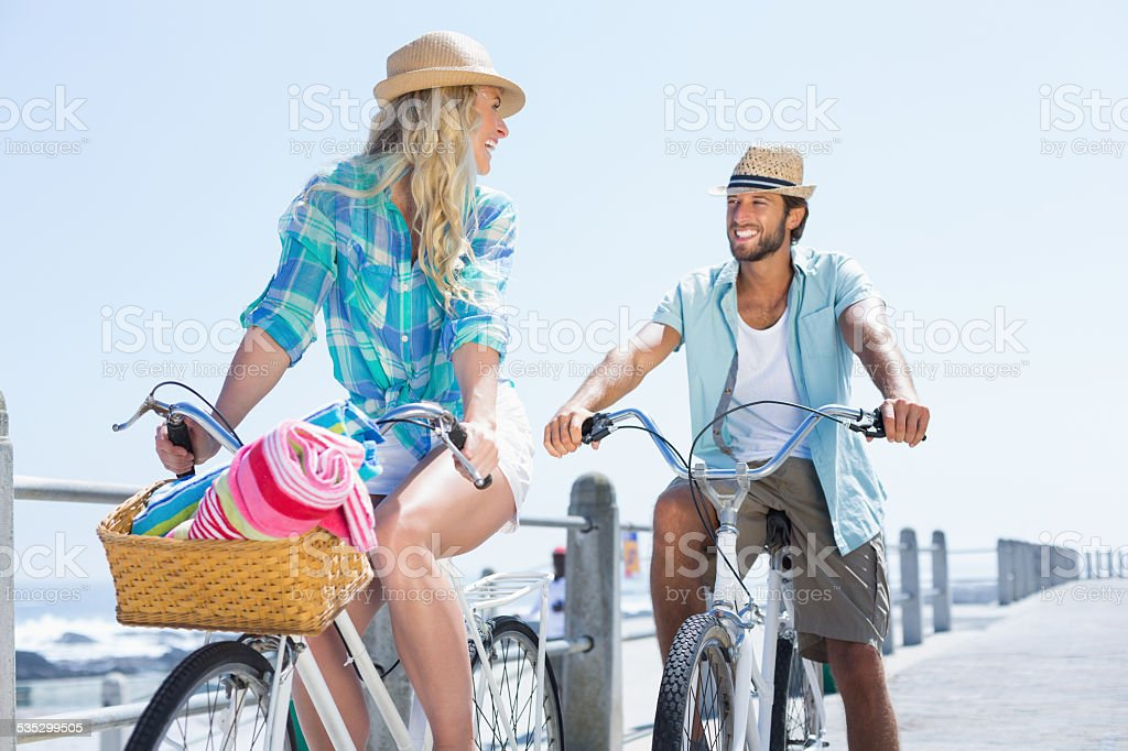 Cute couple on a bike ride stock photo