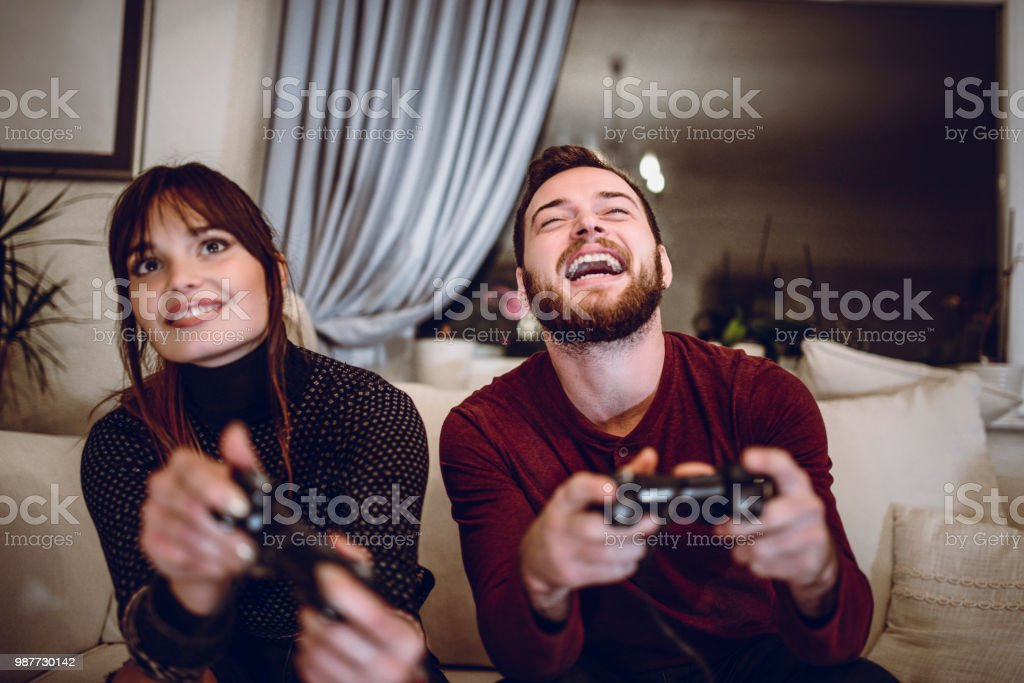 Cute Couple Playing Video Games Together Stock Photo Download Image Now Istock