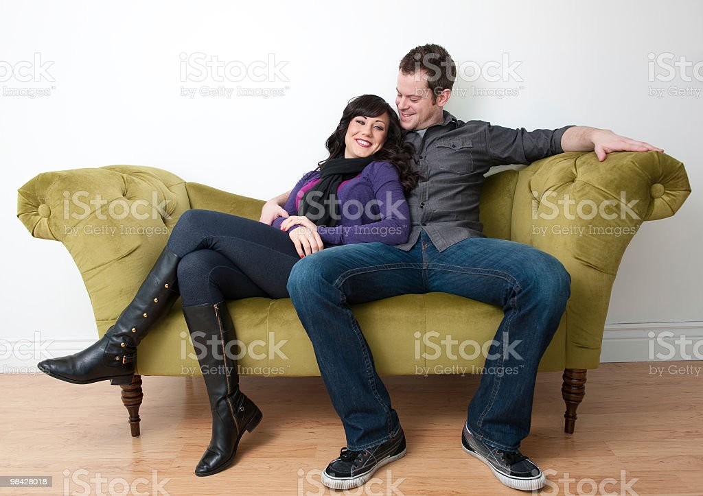 cute couple relaxing on a sofa royalty-free stock photo