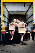istock Cute couple wearing boxes and kissing 108268618