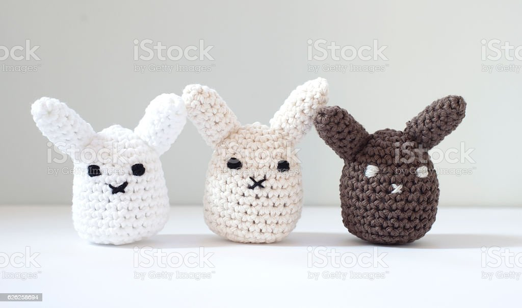 Cute crocheted stuffed bunnies stock photo
