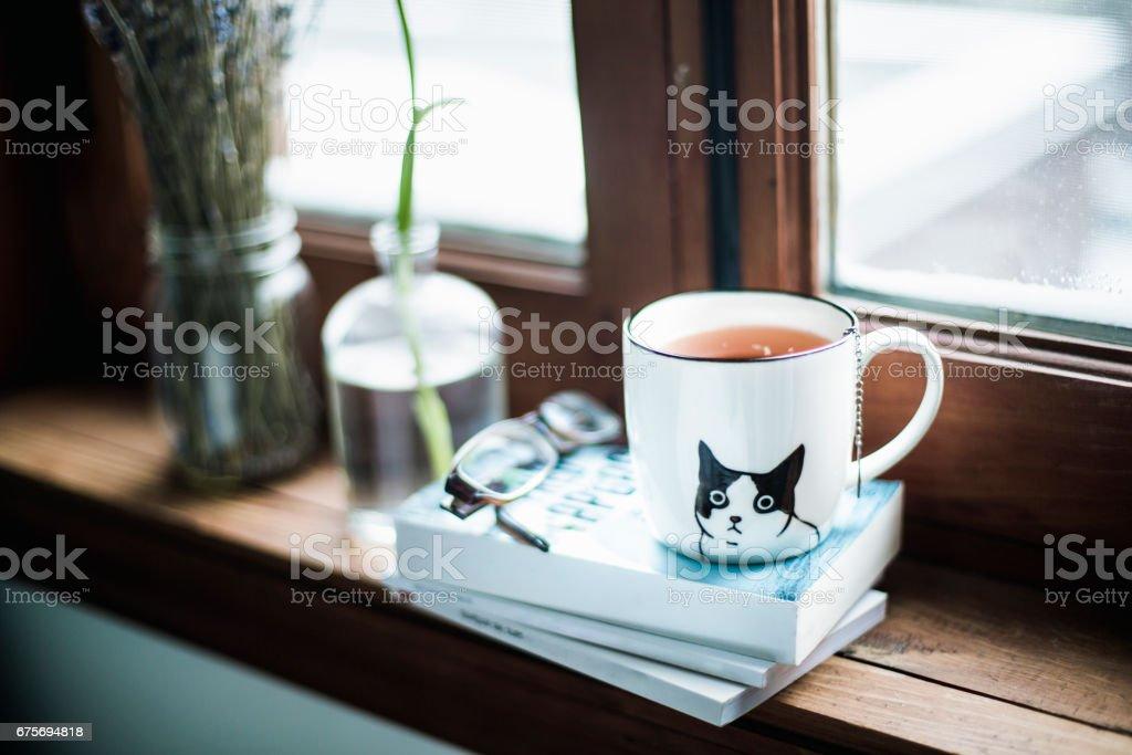 A cute cup a tea on books stock photo