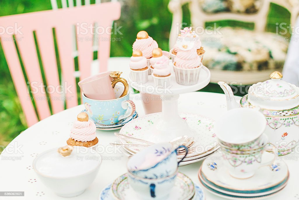 Cute cupcakes on dessert table stock photo