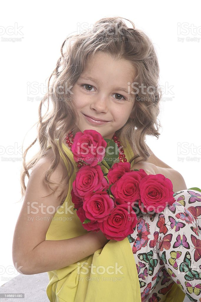 Cute curly girl posing with roses royalty-free stock photo