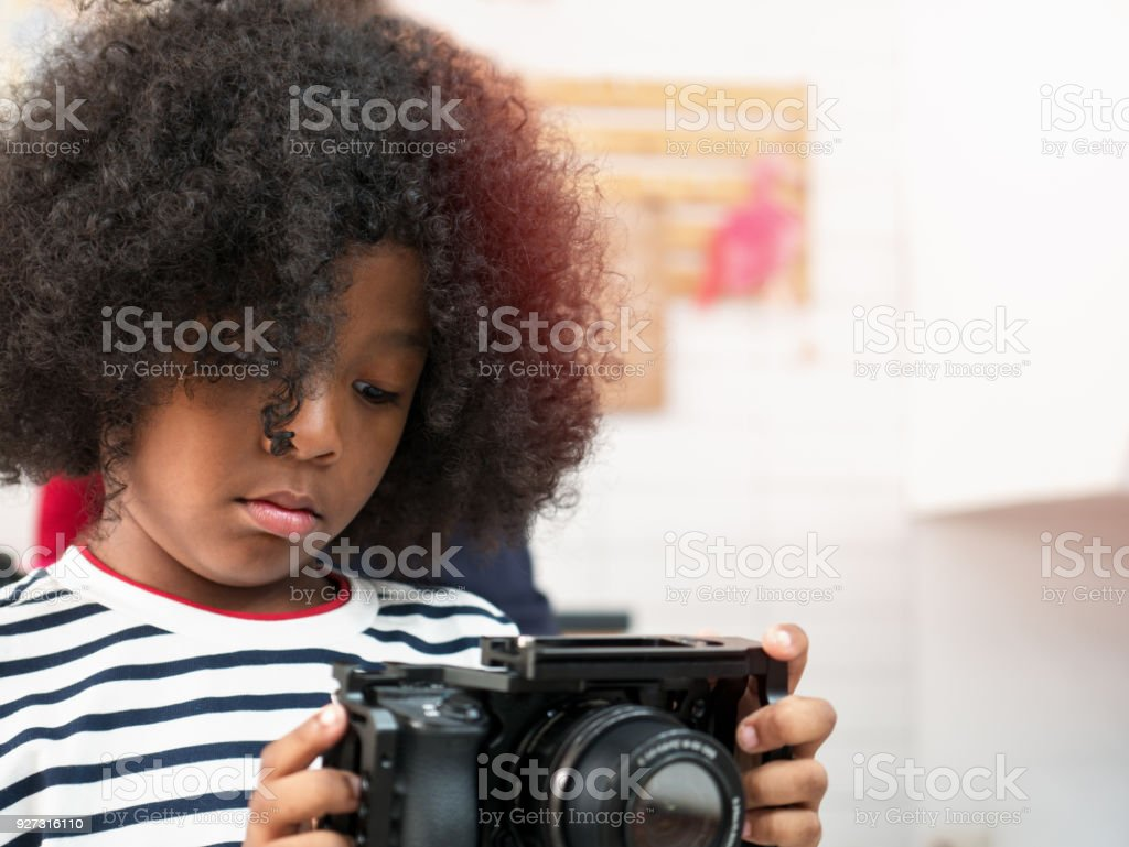 Cute Curly Hair Boy Interesting And Playing With Camera Stock Photo Download Image Now Istock