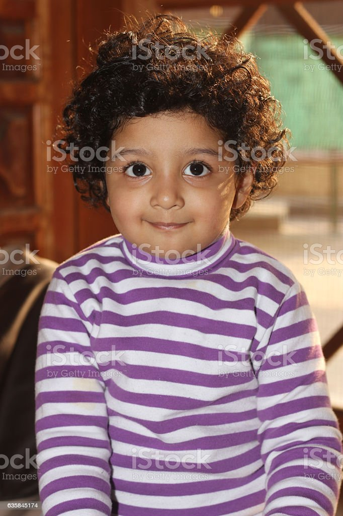 Cute Curly Hair Light Skin South Asian Boy Stock Photo