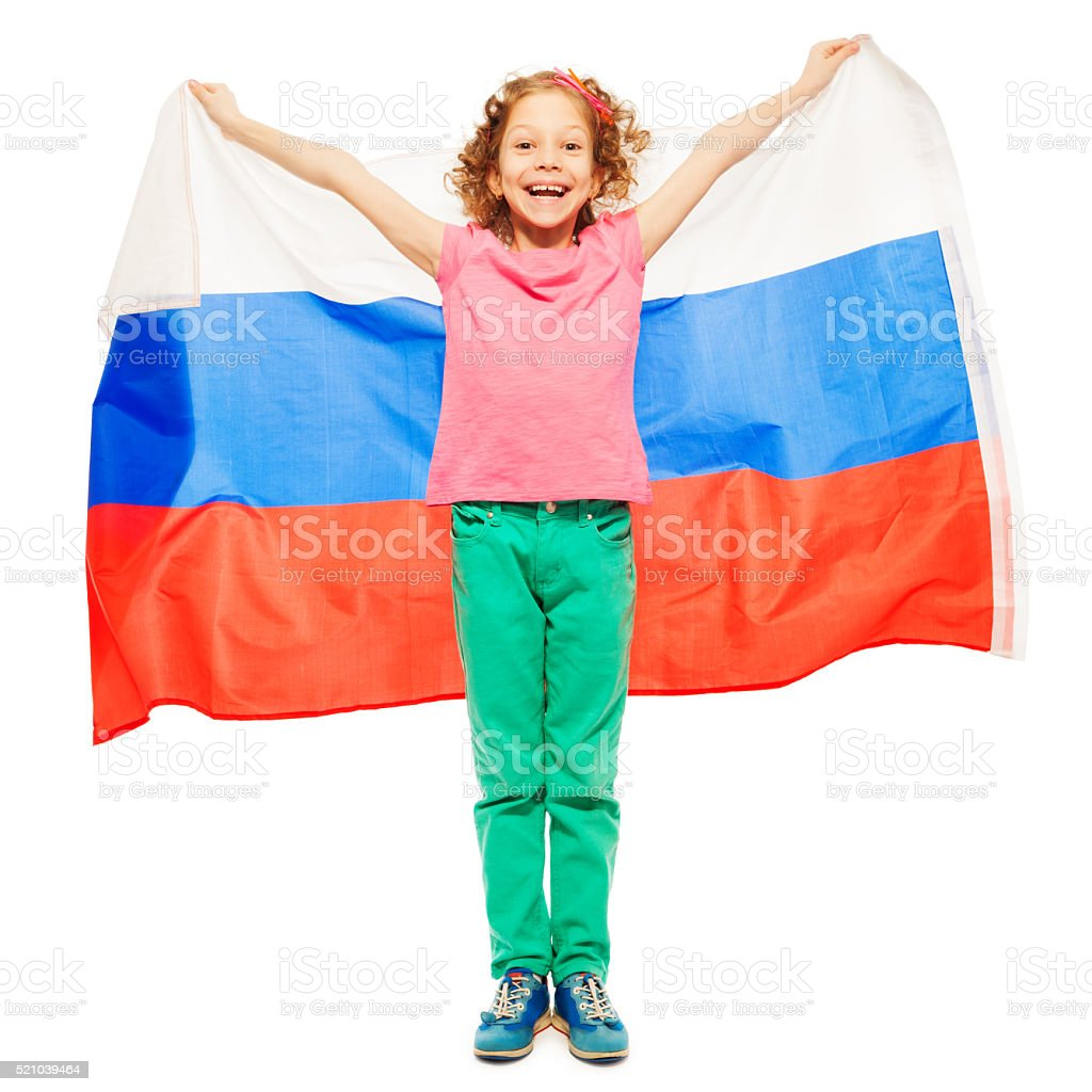 Cute curly-haired girl waving a Russian flag stock photo