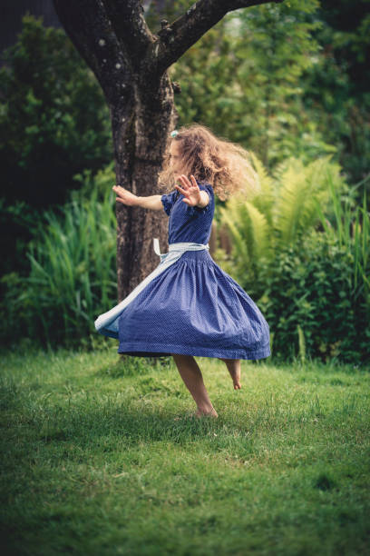 2da355f86c0c Cute Dancing Little Girl In A Bavarian Dirndl Dress Stock Photo & More  Pictures of Barefoot - iStock