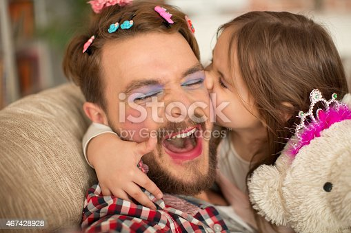 istock Cute daughter and her father having princess time. 467428928