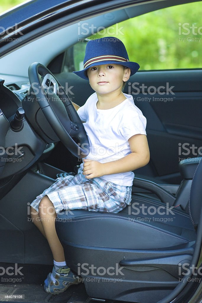Cute driver sits in car royalty-free stock photo