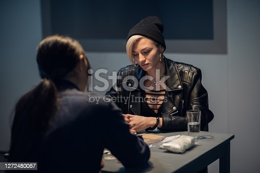 istock cute drug dealer being questioned at police station 1272480057