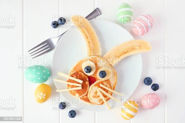 Cute easter bunny pancakes on a white plate top view over white wood picture id1207601030?b=1&k=6&m=1207601030&s=612x612&h=ycyjppb15cusbmftabdd9hrzrbjfqk8gu0srtjjc3dm=