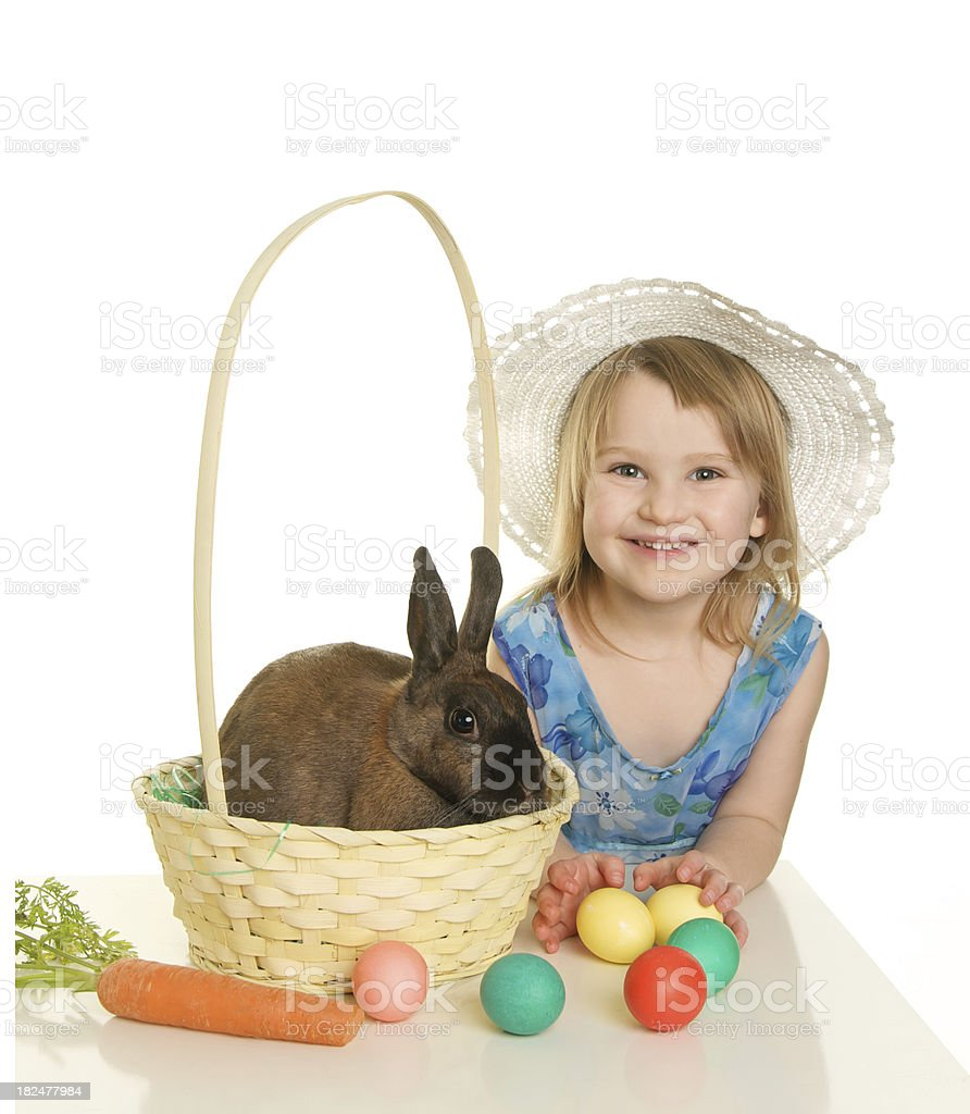 Cute Easter Girl with a Bonnet Basket Eggs and Bunny royalty-free stock photo