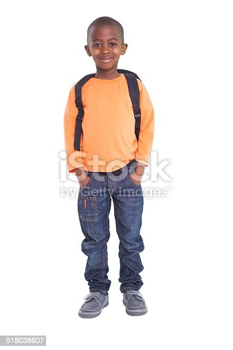 istock Cute elementary pupil smiling at camera 518038607