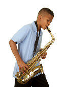 A handsome eleven year old African American boy playing the saxophone on a white background