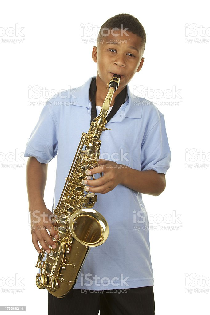 Cute Eleven Year Old Boy Playing the Saxophone stock photo